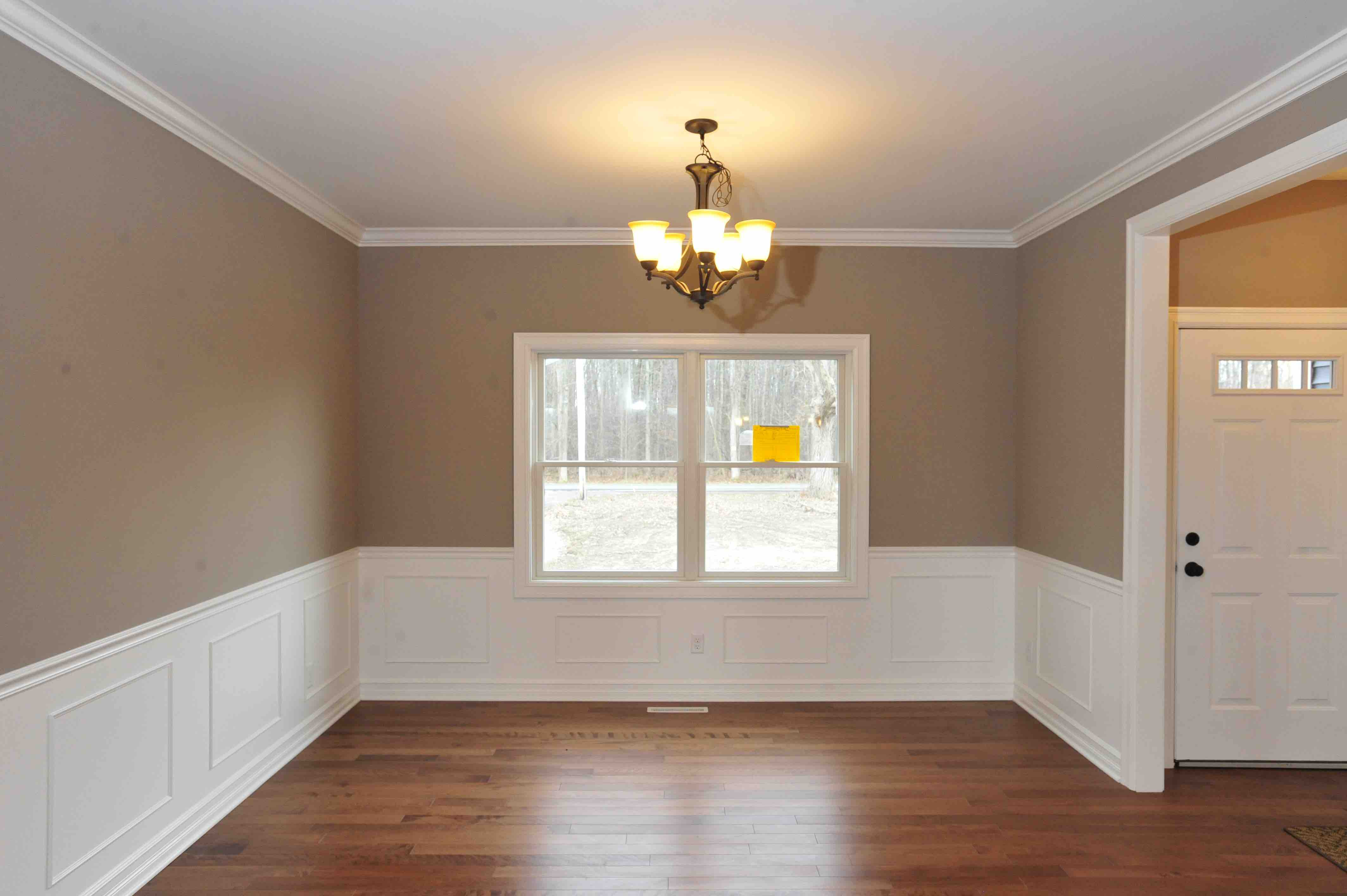 Image gallery lps custom homes for Dining room wall molding ideas