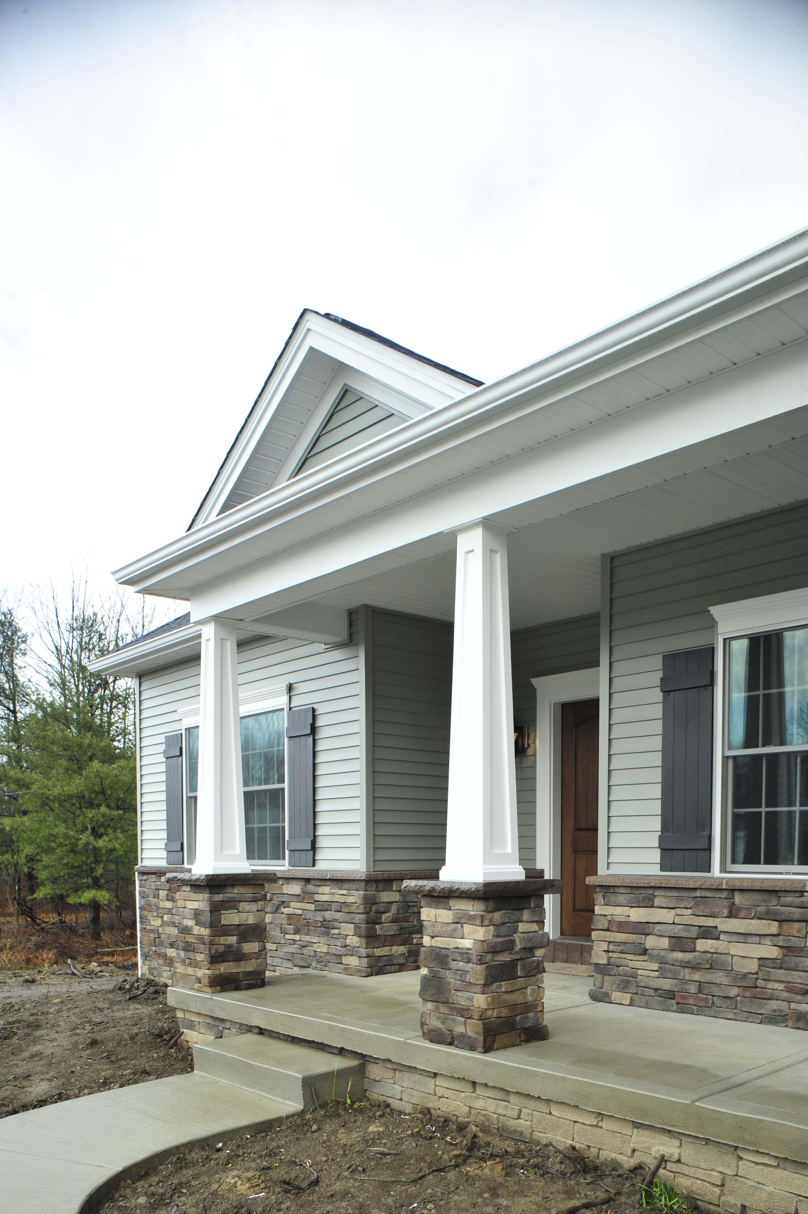 Ranch style house with stone front porch joy studio for Stacked stone house