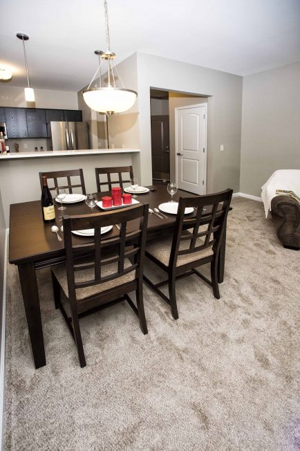 This two-bedroom model shows a dining area and a sit-at snack bar.