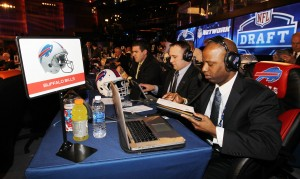 The Buffalo Bills' Casey Weidl, Spencer Haws and Shone Gipson sit at the Bills draft table just minutes before the start of the 2014 NFL draft at Radio City Music Hall in New York City. (James P. McCoy/Buffalo News)