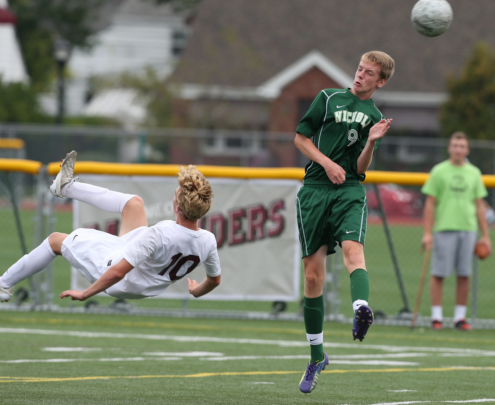 St. Joes Hunter Walsh executes a bicycle kick against Nichols on Sept. 10, 2014. (James P. McCoy/Buffalo News file photo)
