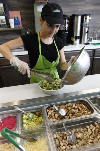 Petrik creates a salad to order at Newbury Street Cafe. (Sharon Cantillon / Buffalo News)