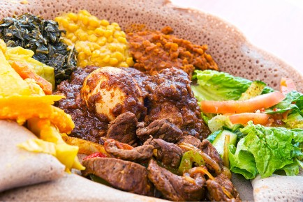 A combination plate at Abyssinia is served atop Ethiopian injera, a spongy flatbread.
