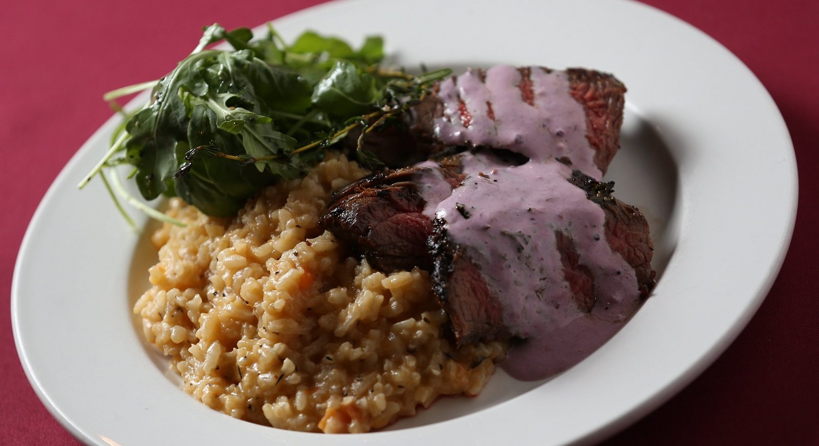 flank steak comes with yam, feta risotto, dressed arugula and a wasabi ...