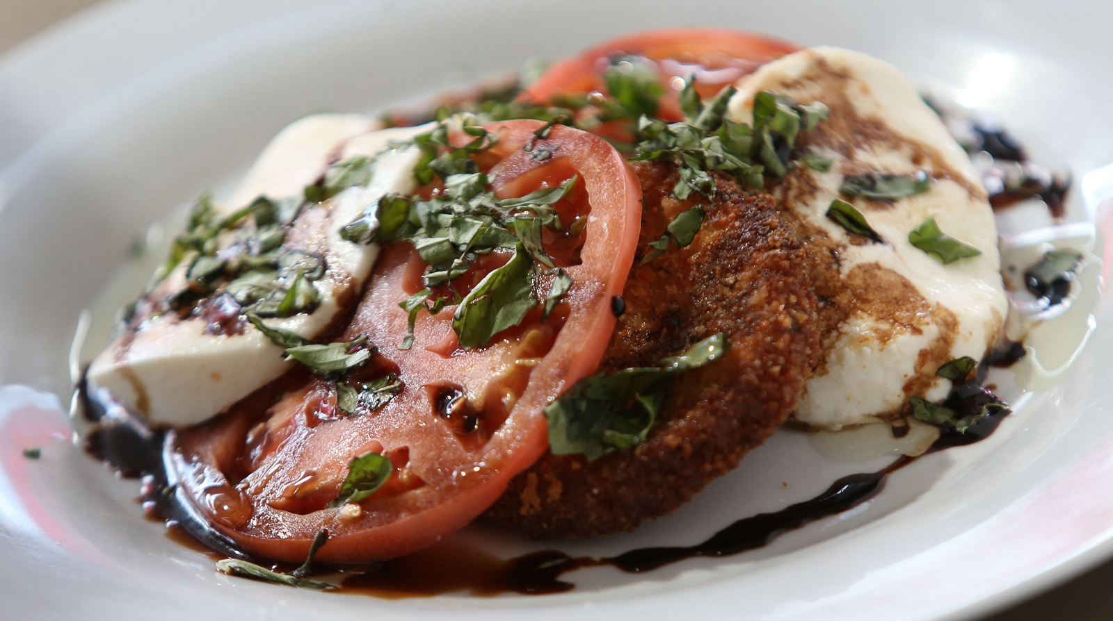 Share Kitchen's eggplant Caprese is made with fried eggplant, tomato ...