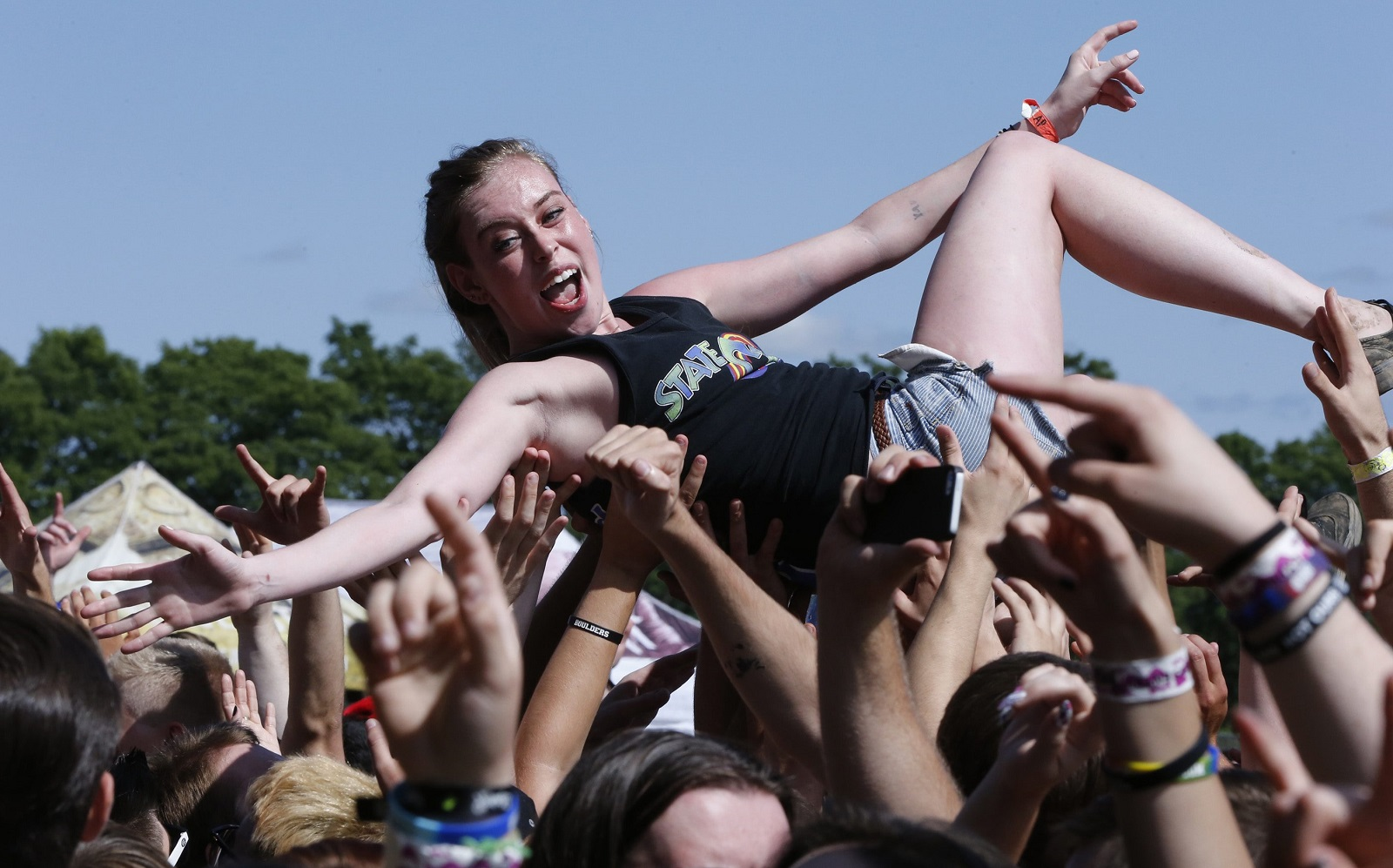 3c0dc1cf43fd A fan crowd-surfs during Beartooth s performance at the Warped Tour at Darien  Lake.
